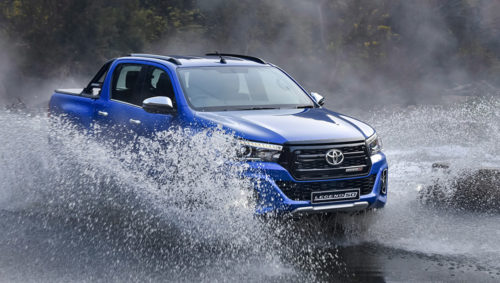 Blue Toyota Hilux Legend 50 fording river